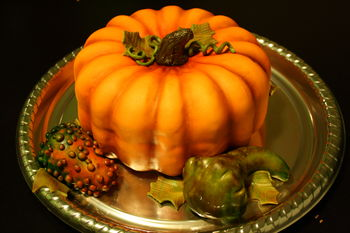 Fall themed cake that I'm donating to a silent auction...everything is made out of cake :) First time airbrushing too.