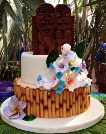 Luau themed cake with all MMF decorations - including bamboo, flowers & tiki