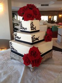 Square Wedding Cake- With rose topper.  But the Groom had another vision for this.....
