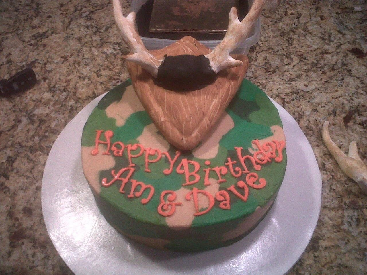 Camo cake done in buttercream technique learned on cc Rice Krispie plaque covered in fondant with gum paste antlers