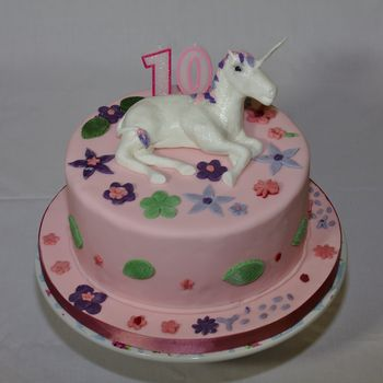 This cake was decorated using the unicorn from the previous cake and then I let my children and a friend loose with some fondant and cutters.