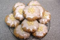 Holiday EGGNOG CINNAMON cookies with vanilla glaze icing & white chocolate snowflake cut outs.