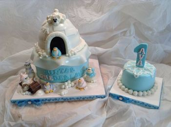 """*I made this for a little girl's 1st birthday. Her Mom wanted a winter theme and let me do what I wanted. 8"""" white cake with a 6"""" carved (igloo) cake with a 4"""" smash cake. All cake is vanilla bean."""