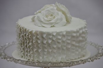 Roses and ruffles.  Chocolate cake filled with chocolate orange buttercream and decorated with sugarpaste roses and vertical ruffles.