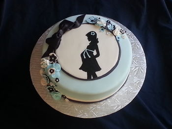 Chocolate cake with vanilla buttercream and marshmallow fondant..  Silhouette is hand painted with marshmallow fondant details.