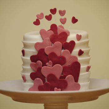 """A little 4"""" almond rose cake with raspberry curd filling, decorated with sugarpaste.  This was just a quickie for my husband, using up left-over scraps of sugarpaste."""