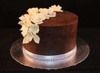This was my first attempt at using the upside down method to achieve sharp edges on a cake with ganache.  It was also my first try at white modelling chocolate which I have used to make the flowers.  Overall pretty pleased with the outcome.