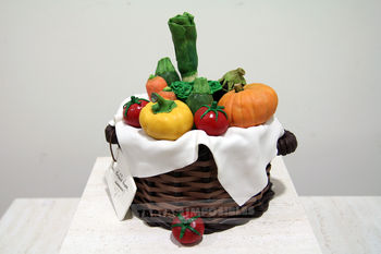 Brownie and hazelnut cream. Basket made with fondant and modelling chocolate. All vegetables made with RKT and white modelling chocolate.