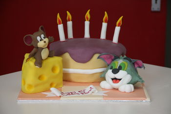 A cake for a 5 year old that LOVES Tom and Jerry   The cheese and cake are both vanilla sponge with vanilla frosting, figures and candles are half and half, ears on tom are flower paste along with the banner.