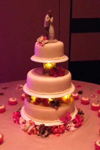 Showing the cake again when the lighting in the room was dimmed.  You can see the lights in between the tiers.