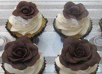 homemade modeling chocolate roses, SMBC & vanilla cupcakes.