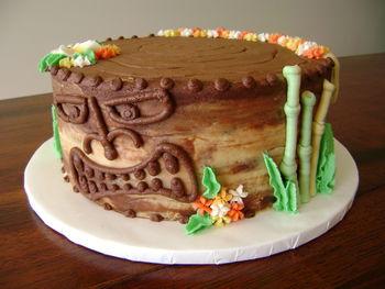"Luau themed, banana cake, peanutbutter-chocolate ABC, piped tiki face/hula skirt/ bamboo, drop flowers, 9"""