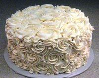 Swiss meringue buttercream on devil's food cake.  Rosettes.