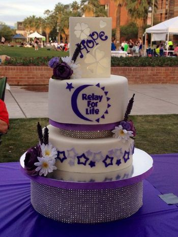 It was an honor to create this cake for the Survivor's Dinner at University of Arizona's 2014 Relay for Life.  The top is a gumpaste luminaria with a battery operated tea light inside, the rhinestone base is a cake dummy.