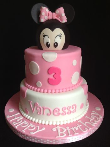 Minnie Mouse is covered on a styrofoam ball. Top tier is rice krispies, bottom tier is chocolate cake with chocolate buttercream.