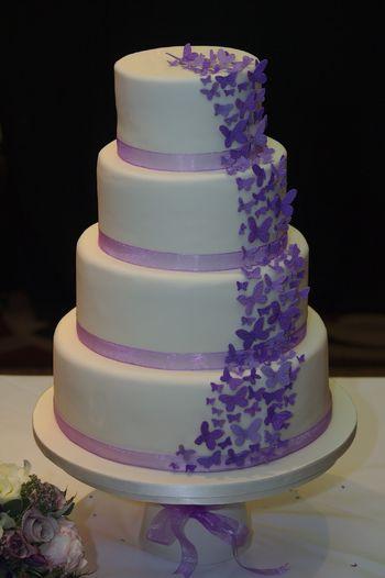 A cascade of purple gumpaste butterflies.