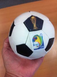 Complete sphere lemon sponge football cake for World Cup 2014