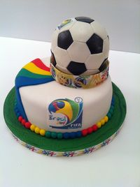 Cake on a cake made for work raffle for opening day of World Cup Brazil 2014 Football tournament.