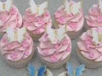 Swiss Meringue Buttercream, Vanilla cupcakes, Satin Ice fondant butterflies & flowers.