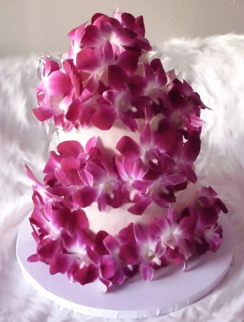"4"", 6"", 8"" tiered vanilla cake with light pink vanilla frosting colored with all natural food coloring. This is my first time stacking only buttercream and using fresh flowers.  The flowers are actually edible orchids, so they can be served with the cake (they have a slight sweet flavor when eaten)."