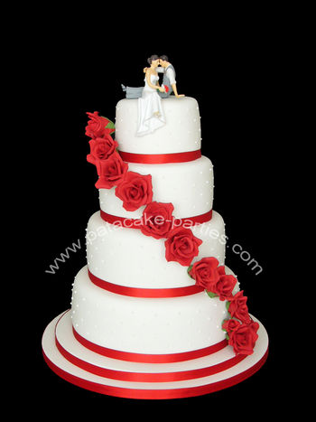 A design I've done a couple of times before, but this time with a topper supplied by the customer.  4 tiers of red velvet cake with cream cheese frosting, covered with marzipan and sugarpaste and decorated with piped royal icing pearls and hand-made sugar roses.