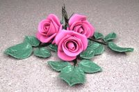 Gumpaste Roses and leaves 1st try.