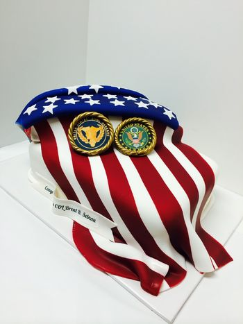 This is a 2 tier cake, bottom tier has 4-layers and top tier is 2 layers triangle shaped.  The flag is edible airbrush fondant draped over butter-vanilla cakes.