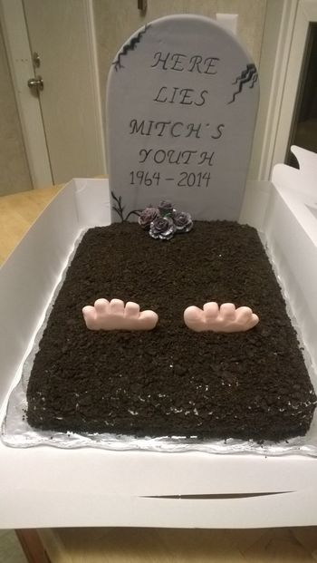 1/2 sheet, buttercream iced, covered in crushed Oreo cookies. Fondant covered foamboard tombstone, gum paste roses, fondant feet. Hope I Do Not get a similar cake for my 50th!