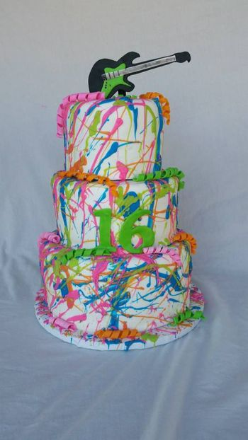 Neon Splatter cake with fondant guitar. The neon splatter was white chocolate melts