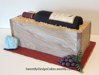 "Cake measures 6"" x 14"". Sugar paste wine bottle, cheese and grapes."