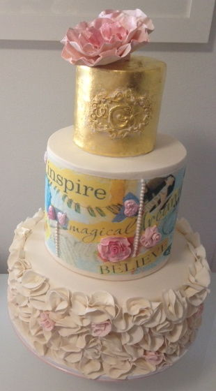 Wedding cake for my darling niece. Ruffles, gold leaf, edible images of a collage (depicting themes the couple requested), pearls and ruffle flowers.