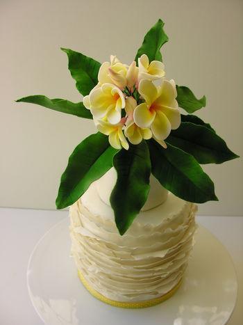 Frangipanis.  Top cake of cupcake tower.