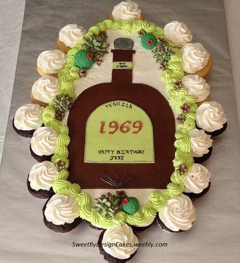 Pull apart / cupcake cake with fondant tequila bottle and succulents.