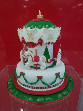 Christmas cake I did for a raffle . It is made from rich fruitcake.