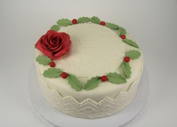 marshmallow fondant, lace molds, gumpaste red rose, holly & berries.