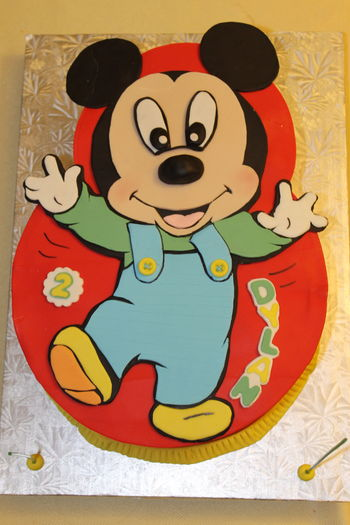Dancing baby Mickey cake for my nephew (white butter cake with caramel and orange SMBC, covered/panelled with modeling chocolate, cut outs of modeling chocolate)