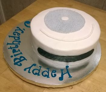 A Roomba self-propelled vacuum cleaner cake for an 8 year old who is fascinated by them. Buttercream cake, fondant tappit letters.