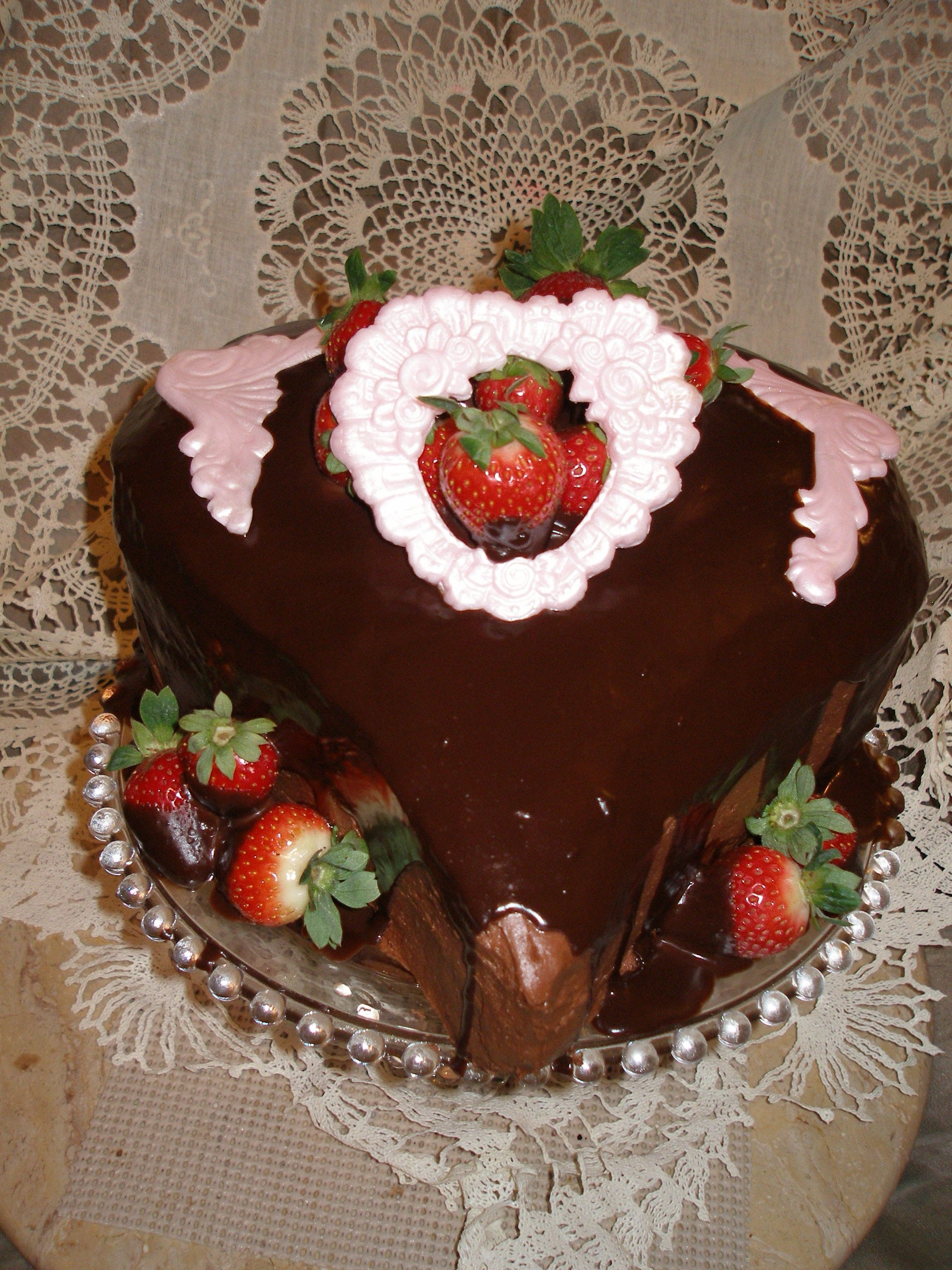 Decadent chocolate cake with bavarian creme/chocolate ganache filling along with one layer of raspberry filling. Covered by chocolate buttercream and chocolate ganache drizzle. Garnished by ganache dipped strawberries and fondant accents. It was a...