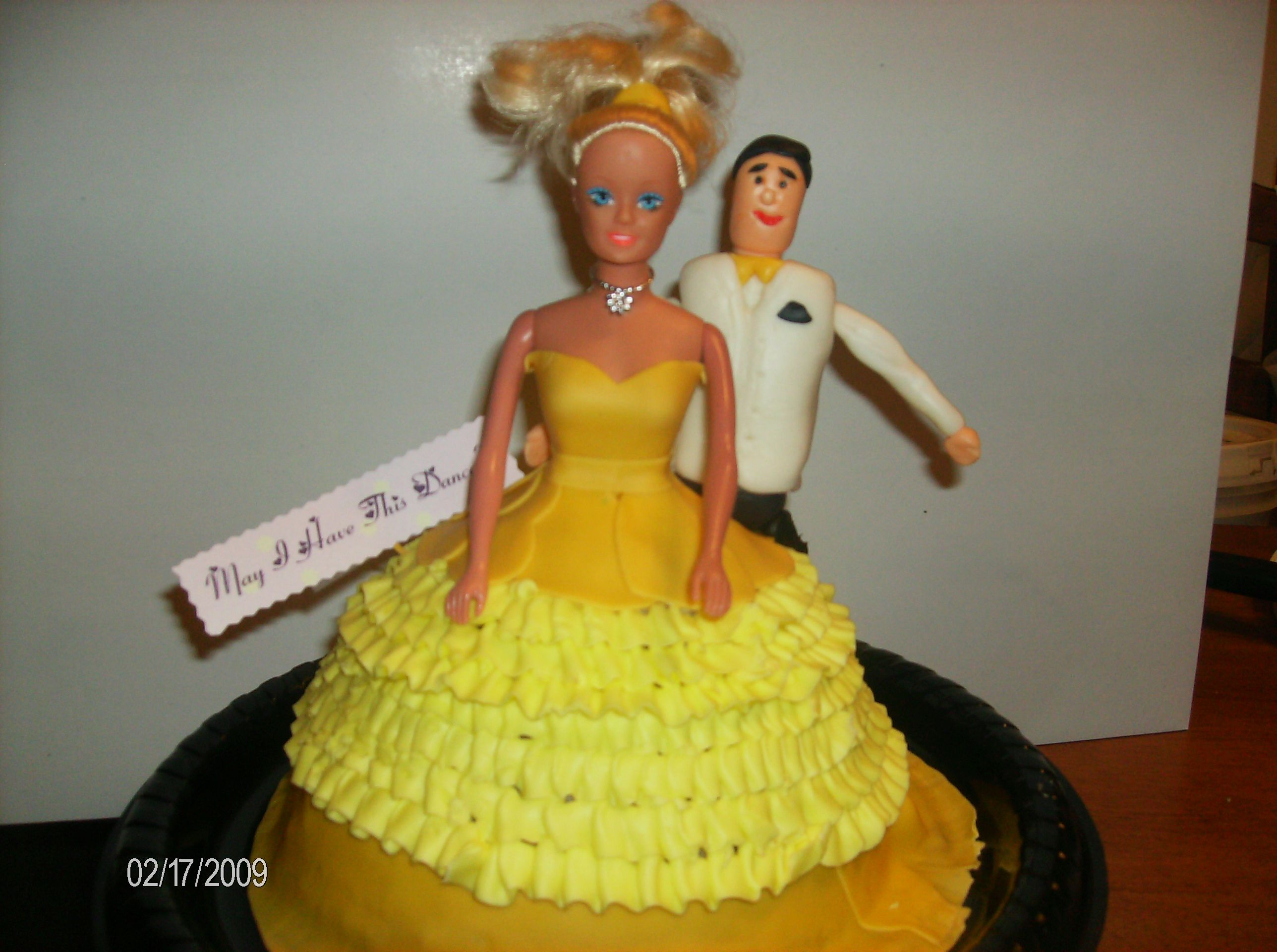Traditional Barbie cake added a Fondant Fellow at her side ready to sweep her off her feet at the ball.