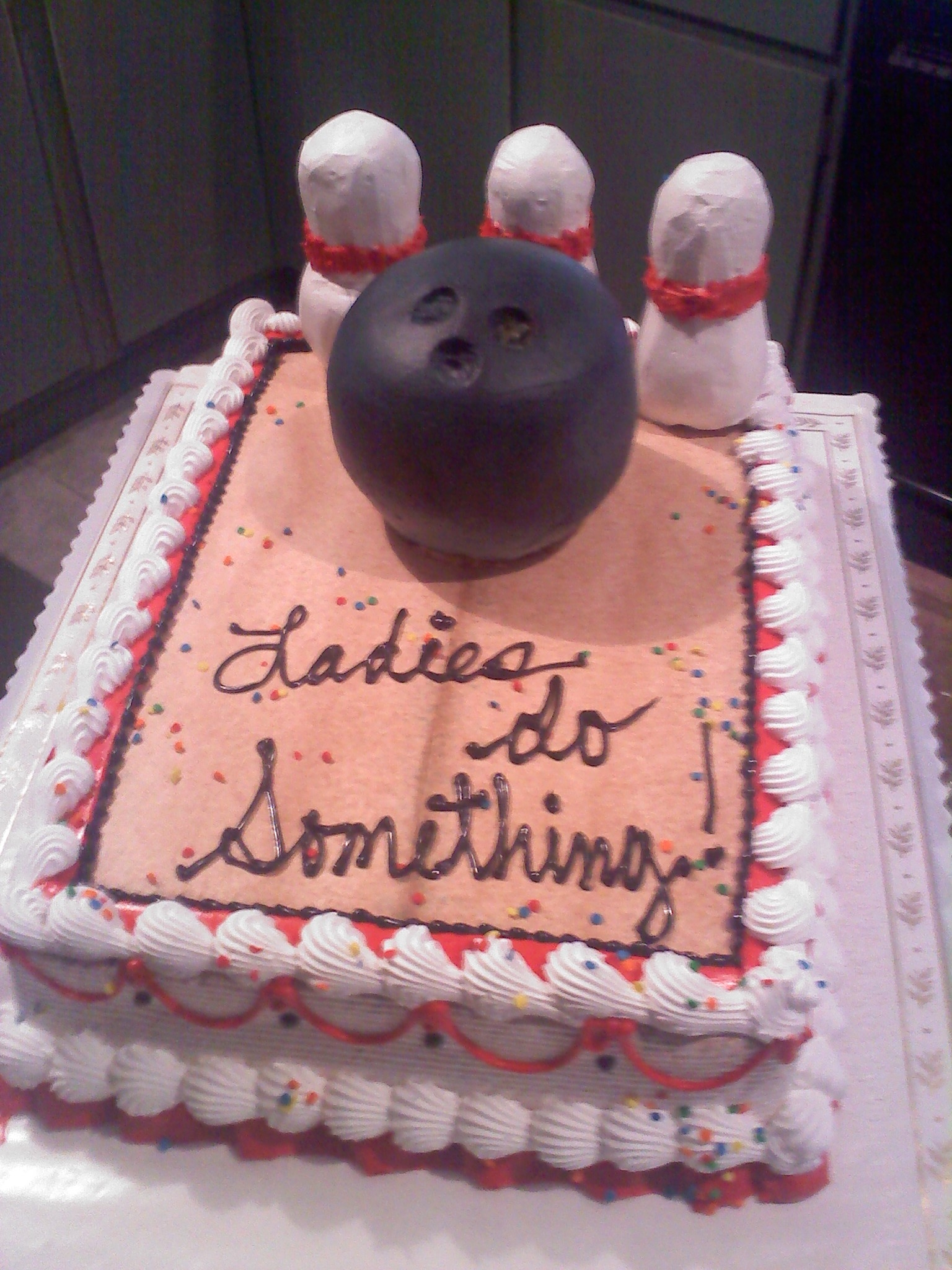 All covered in whip cream.  All edible including sculpted bowling ball cake.  My pins were made of twinkies and held dowm by a straw.  They didn't come out as I hoped but otherwise happy with it over all.