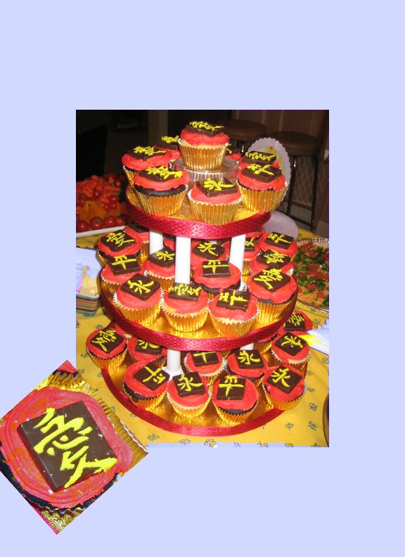 This cupcake tower was for my friend's baby shower to celebrate the impending arrival of her baby girl she is adopting from China that she waited over 2 years for. Used buttercream icing in (no-taste) red, yellow on homemade chocolate squares and gold edible glitter, all traditionally lucky colours in Chinese culture. The symbols represent love, eternity and peace.