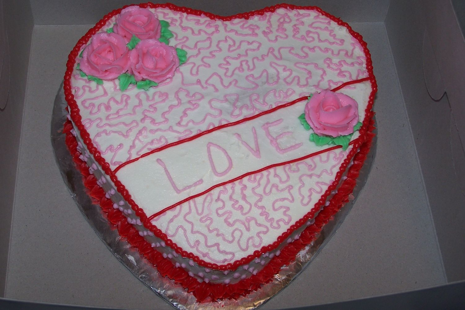 My first decorated Valentine's Day cake (I've been decorating for 3 months).  All buttercream icing.