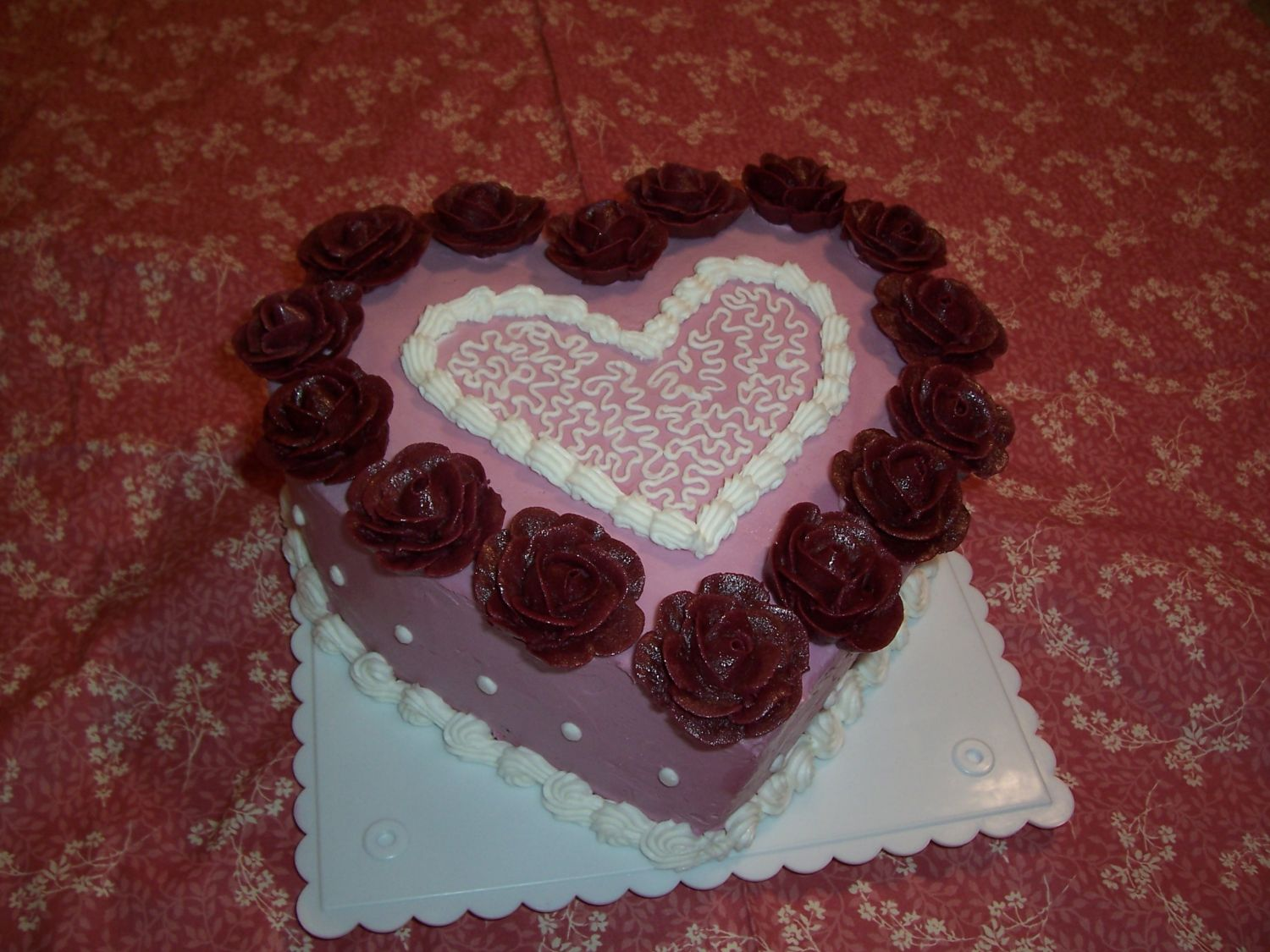 Valentine's cake done just for the heck of it.   Decorations are all buttercream and the cake is chocolate.