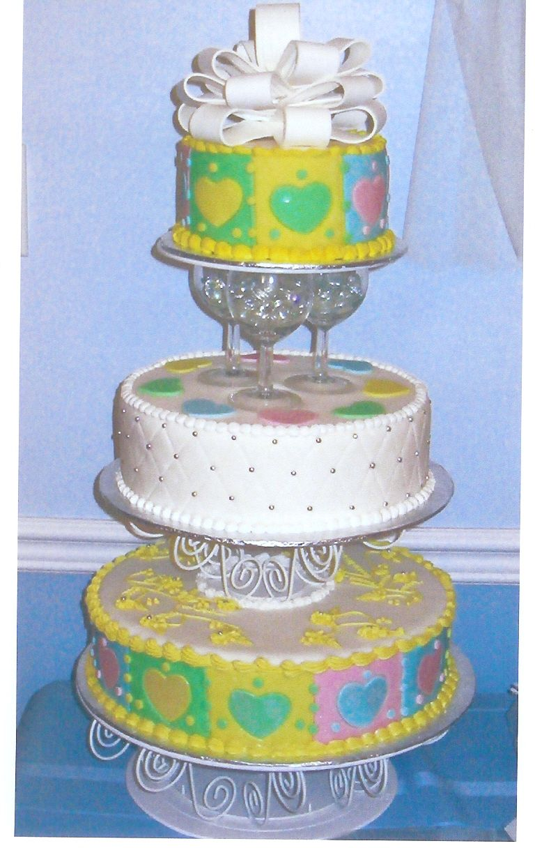 This was a wedding cake I created using fondant and the new Wilton Separator Plates.  The centre tier is quilted. 
