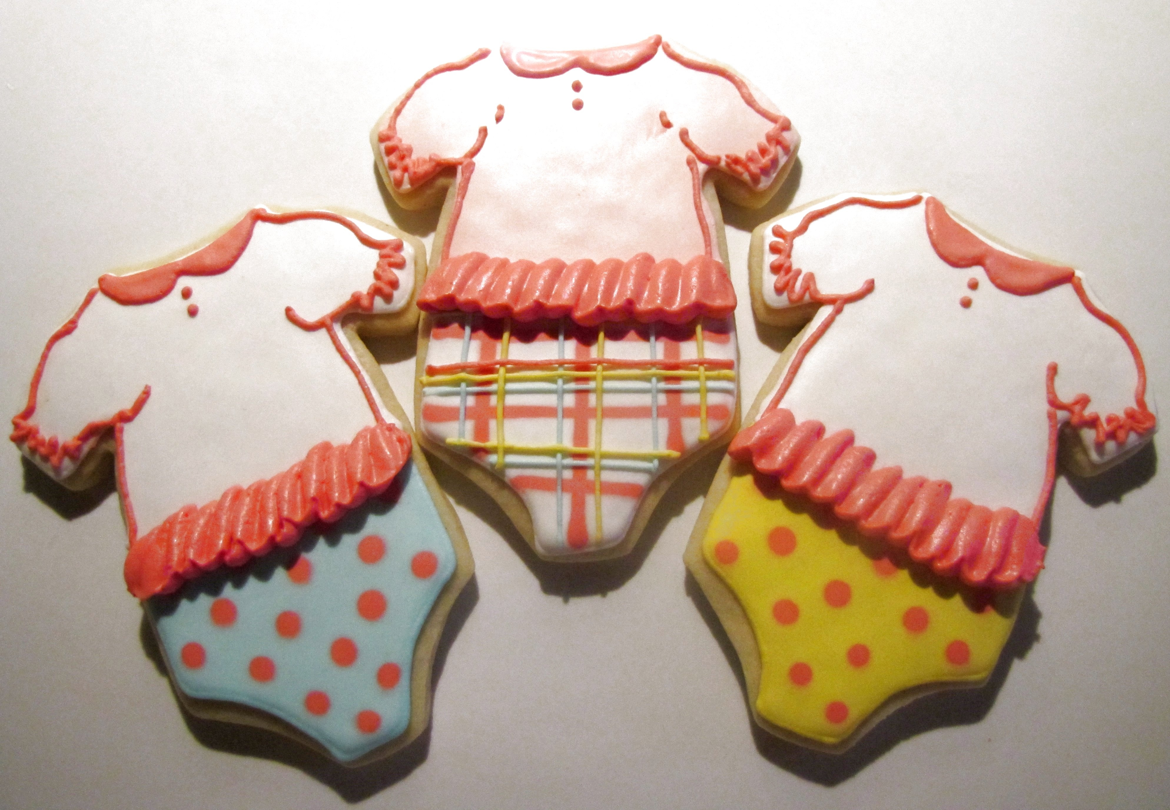 Ruffled baby girl onesies.  Vanilla sugar cookies with a modified RI.  Sorry for the poor quality photo; had to take it at night!