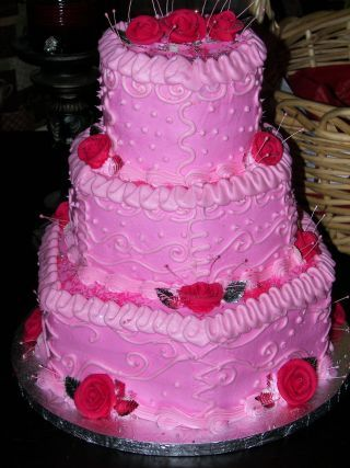 Three tier Hexagon shape with strawberry flavored cake and fresh fruit strawberry filling
