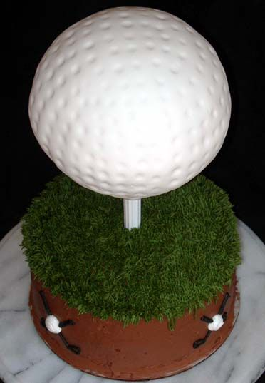All buttercream on grass layer, fondant covered 3-d golf ball.