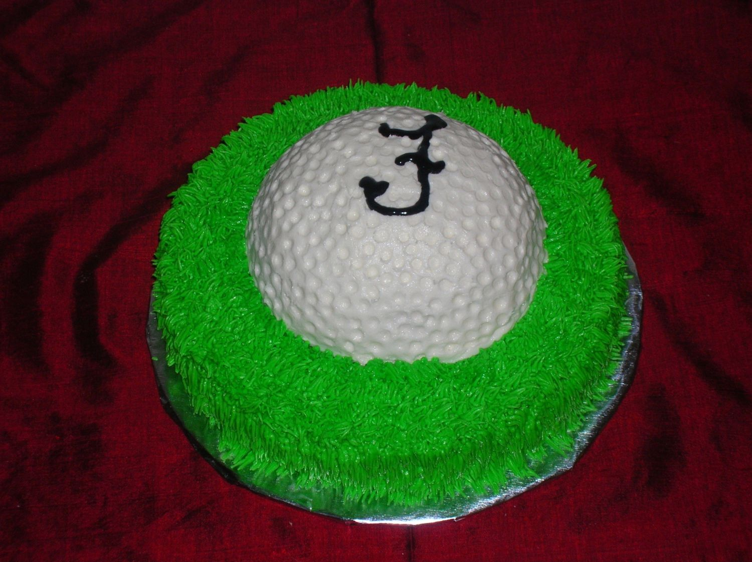 One half of sports ball cake on top of 9inch cake.  Lemon cake with lemon buttercream.