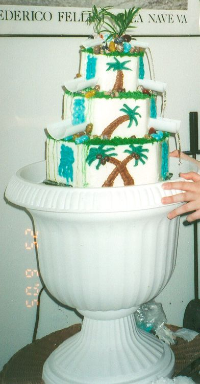 My best friend decided that she just HAD to have a waterfall with REAL WATER on her cake. I said no at first of course, but after a professional cake decorator told me it was impossible I was committed to do it! lol. The cake was passion fruit/guava/papaya with pineapple filling and coconut BC, hence the tropical decorations.