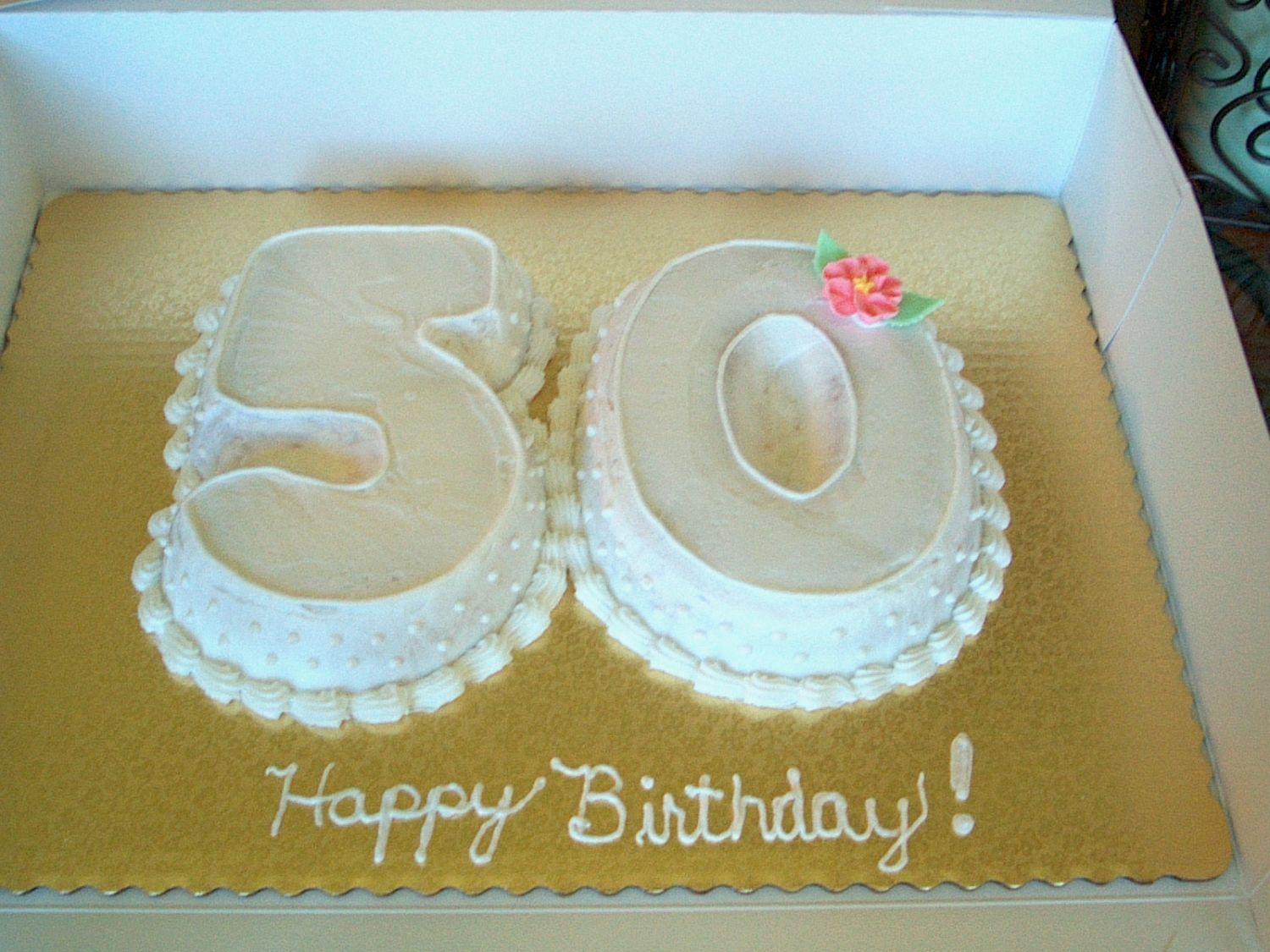 Cake for a 50th birthday.  They wanted simple and elegant and the numbers 5 and 0.